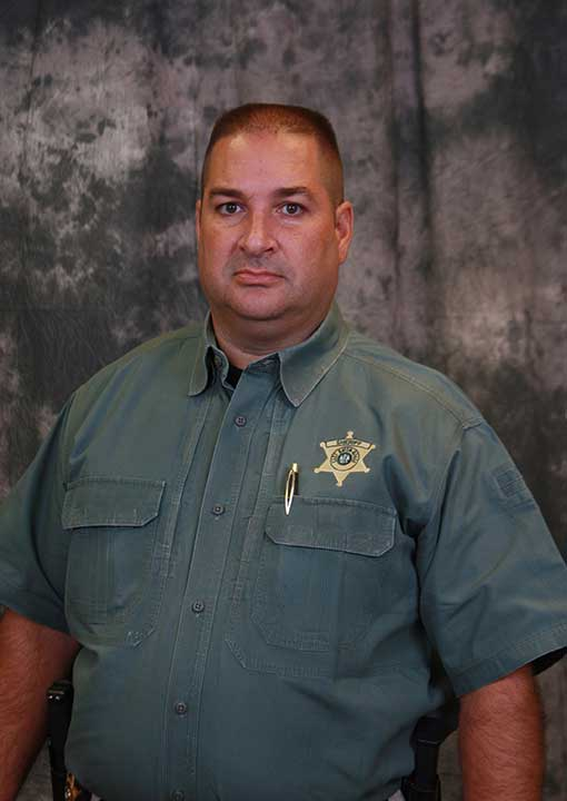 <div class='meta'><div class='origin-logo' data-origin='none'></div><span class='caption-text' data-credit='East Baton Rouge Sheriff's Office via AP'>This undated photo made available by the East Baton Rouge Sheriff's Office shows deputy Brad Garafola. Garafola, 45, was one of the officers killed.</span></div>