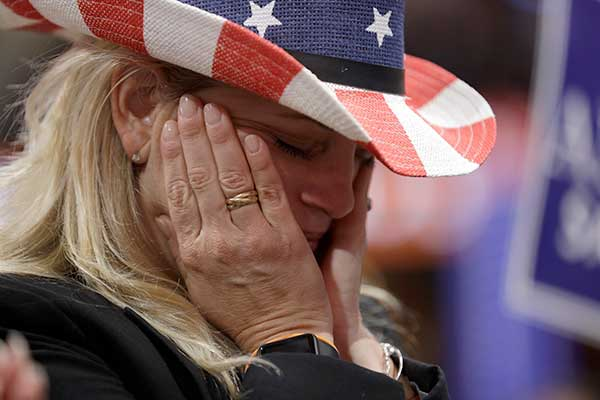 <div class='meta'><div class='origin-logo' data-origin='none'></div><span class='caption-text' data-credit='John Locher/AP Photo'>California delegate Donna Lowe cries as she listens to a speech by retired U.S. Navy Seal Marcus Luttrell during first day of the Republican National Convention on Monday.</span></div>