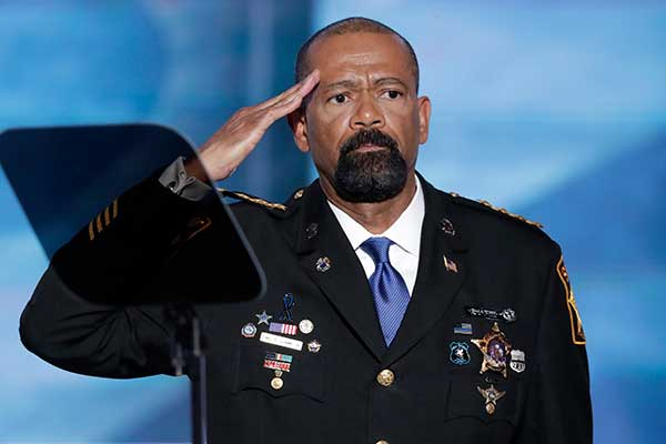 <div class='meta'><div class='origin-logo' data-origin='none'></div><span class='caption-text' data-credit='J. Scott Applewhite/AP Photo'>David Clarke, Sheriff of Milwaukee County, Wis., salutes after speaking during the opening day of the Republican National Convention in Cleveland</span></div>