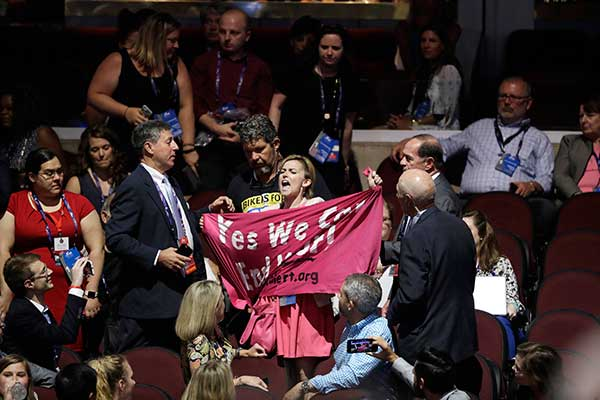 <div class='meta'><div class='origin-logo' data-origin='none'></div><span class='caption-text' data-credit='John Locher/AP Photo'>A protester scuffles with others delegates during first day of the Republican National Convention in Cleveland.</span></div>