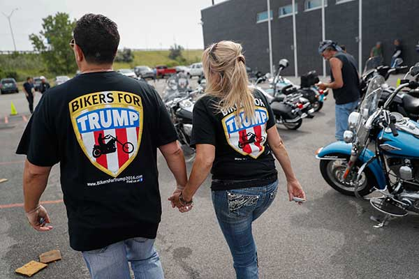 <div class='meta'><div class='origin-logo' data-origin='none'></div><span class='caption-text' data-credit='John Minchillo/AP Photo'>Supporters participate in a Bikers for Trump rally and ride for Republican Presidential candidate Donald Trump on Monday, July 18, 2016, in Cleveland.</span></div>
