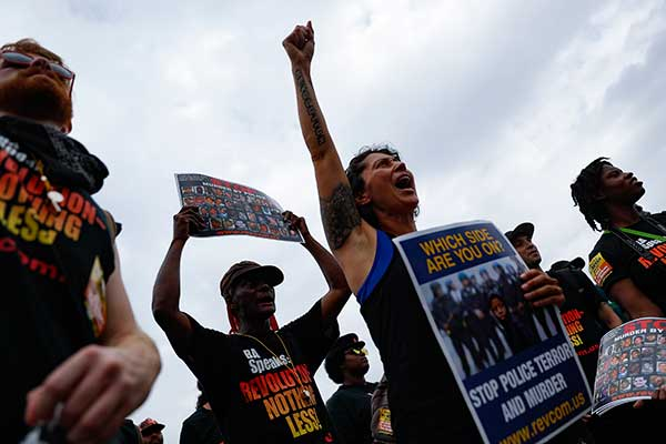 <div class='meta'><div class='origin-logo' data-origin='none'></div><span class='caption-text' data-credit='John Minchillo/AP Photo'>Demonstrators react during an End Poverty Now rally on Monday, July 18, 2016, in Cleveland.</span></div>