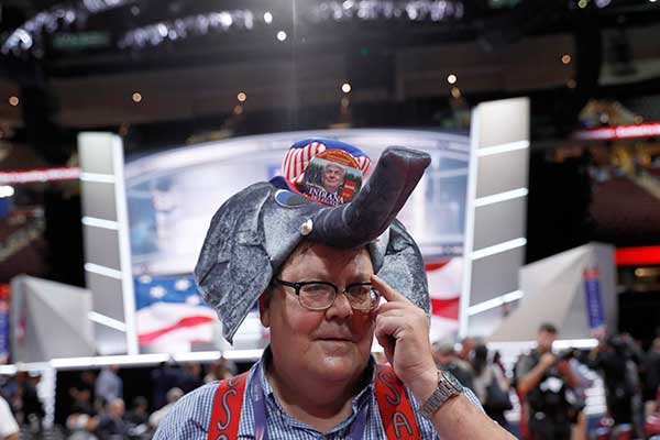<div class='meta'><div class='origin-logo' data-origin='none'></div><span class='caption-text' data-credit='Carolyn Kaster/AP Photo'>Indiana delegate William Springer wears an elephant hat with Trump button as he walks around the convention floor before the evening session on Monday.</span></div>