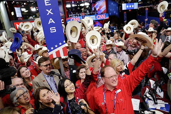 <div class='meta'><div class='origin-logo' data-origin='none'></div><span class='caption-text' data-credit='John Locher/AP Photo'>Texas delegates cheer during the second day session of the Republican National Convention in Cleveland, Tuesday, July 19, 2016.</span></div>
