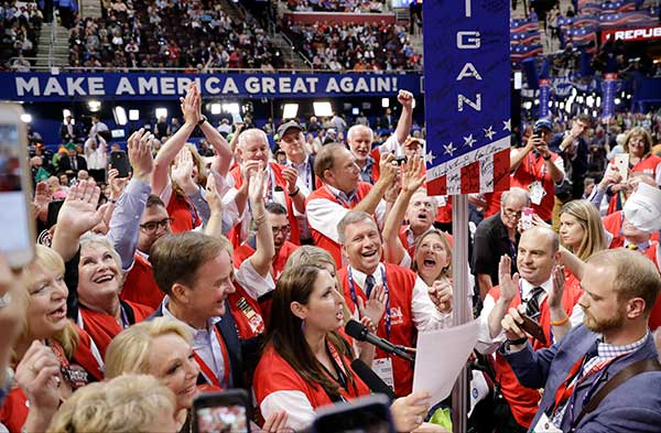 <div class='meta'><div class='origin-logo' data-origin='none'></div><span class='caption-text' data-credit='Matt Rourke/AP Photo'>Michigan delegates cheer during the second day session of the Republican National Convention in Cleveland, Tuesday, July 19.</span></div>