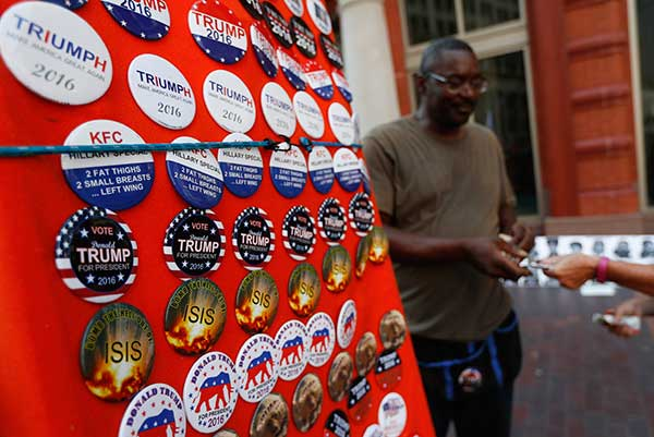 <div class='meta'><div class='origin-logo' data-origin='none'></div><span class='caption-text' data-credit='John Minchillo/AP Photo'>A vendor sells buttons on Euclid Avenue on the second day of the Republican National Convention on Tuesday, July 19, 2016, in Cleveland.</span></div>