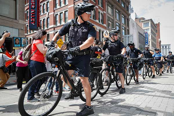 <div class='meta'><div class='origin-logo' data-origin='none'></div><span class='caption-text' data-credit='John Minchillo/AP Photo'>Bicycle police officers guard the street during a protest against the Republican National Convention on Tuesday, July 19, in Cleveland, during the second day of the convention.</span></div>