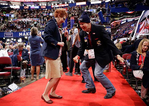 <div class='meta'><div class='origin-logo' data-origin='none'></div><span class='caption-text' data-credit='Matt Rourke/AP Photo'>Oklahoma alternate delegate Debbie House, left, and delegate Allie Burgin dance before the start of the third day session of the Republican National Convention in Cleveland.</span></div>