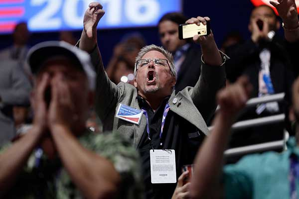 <div class='meta'><div class='origin-logo' data-origin='none'></div><span class='caption-text' data-credit='Matt Rourke/AP Photo'>People react to Sen. Ted Cruz, R-Tex., as Cruz addresses the delegate during the third day session of the Republican National Convention in Cleveland, Wednesday, July 20, 2016.</span></div>