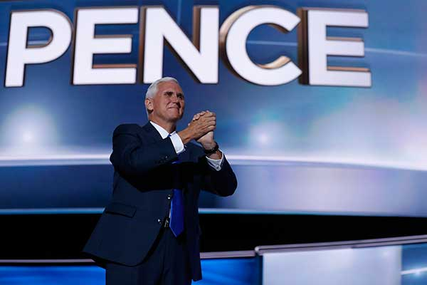 <div class='meta'><div class='origin-logo' data-origin='none'></div><span class='caption-text' data-credit='Mary Altaffer/AP Photo'>Republican vice presidential candidate Gov. Mike Pence, R-Ind., gestures as he arrives on stage to deliver his acceptance speech during the third day session of the RNC.</span></div>