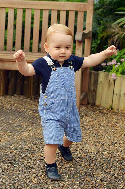 "<div class=""meta image-caption""><div class=""origin-logo origin-image none""><span>none</span></div><span class=""caption-text"">This photo of Prince George walking was released for his first birthday. It was taken at the Sensational Butterflies exhibition at the Natural History Museum in London. (AP Photo/John Stillwell)</span></div>"