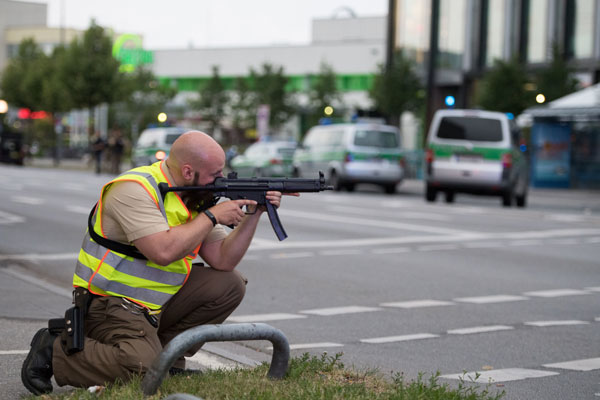 "<div class=""meta image-caption""><div class=""origin-logo origin-image ap""><span>AP</span></div><span class=""caption-text"">Police officers point their weapons outside the Olympia mall in Munich, southern Germany, Friday, July 22, 2016 after several people have been killed in a shooting. (AP Photo/Sebastian Widmann)</span></div>"