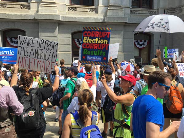<div class='meta'><div class='origin-logo' data-origin='none'></div><span class='caption-text' data-credit=''>Demonstrators rally in support of Bernie Sanders at City Hall in Center City Philadelphia on Monday, July 25, 2016.</span></div>