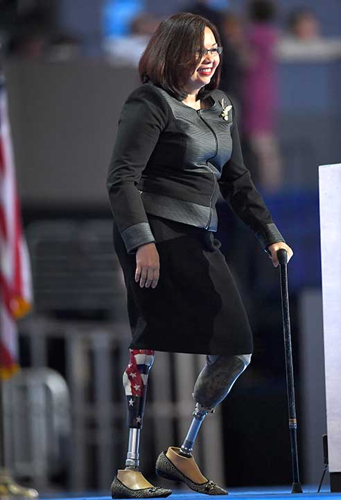 <div class='meta'><div class='origin-logo' data-origin='none'></div><span class='caption-text' data-credit='Mark J. Terrill/AP Photo'>Rep. Tammy Duckworth, D-Ill., takes the stage during the final day of the Democratic National Convention in Philadelphia , Thursday, July 28, 2016.</span></div>