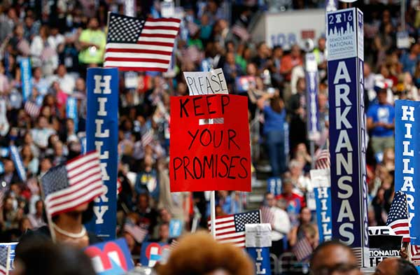 <div class='meta'><div class='origin-logo' data-origin='none'></div><span class='caption-text' data-credit='Carolyn Kaster/AP Photo'>Delegates hold up signs during the final day of the Democratic National Convention in Philadelphia, Thursday, July 28, 2016.</span></div>
