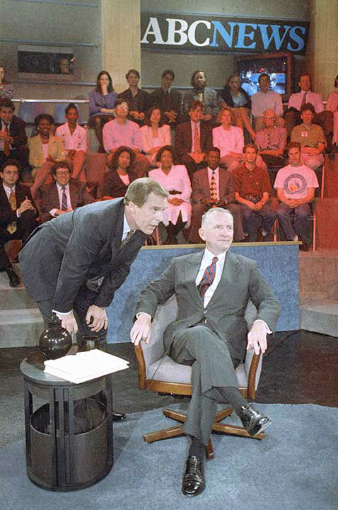 <div class='meta'><div class='origin-logo' data-origin='none'></div><span class='caption-text' data-credit='AP Photo/MARK LENNIHAN'>Jennings points out television camera angles to Ross Perot in 1992 prior to an electronic town hall meeting.</span></div>