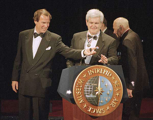 <div class='meta'><div class='origin-logo' data-origin='none'></div><span class='caption-text' data-credit='Photo/AP'>Jennings adjusts the microphone for then Speaker of the House Newt Gingrich during Fleet Week in 1995.</span></div>