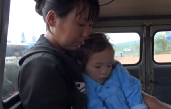 "<div class=""meta image-caption""><div class=""origin-logo origin-image ""><span></span></div><span class=""caption-text"">Reunited with her mother in the back of an ambulance after 11 days gone missing, the two sit solemnly as they recover the recent emotional turmoil. (Photo/Ministry of Emergency Situations in Republic Sakha)</span></div>"