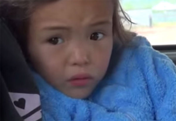 Reunited with her mother in the back of an ambulance after 11 days gone missing, the two sit solemnly as they recover the recent emotional turmoil. <span class=meta>(Photo&#47;Ministry of Emergency Situations in Republic Sakha)</span>