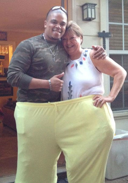 An ''after'' photo of Riser with her trainer, Shaun Lloyd, in her ''before'' pants