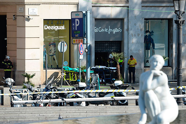 <div class='meta'><div class='origin-logo' data-origin='none'></div><span class='caption-text' data-credit='JOSEP LAGO/AFP/Getty Images'>Firefighters stands outside an evacuated mall after a van plowed into a crowd, injuring pedestrians in Barcelona on August 17, 2017.</span></div>