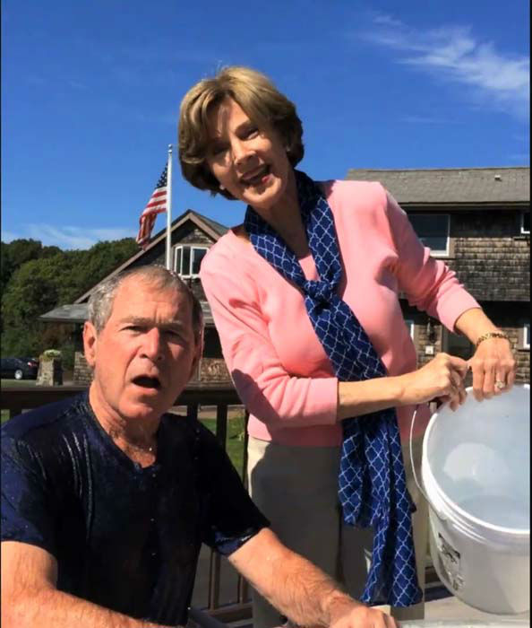 <div class='meta'><div class='origin-logo' data-origin='none'></div><span class='caption-text' data-credit='Facebook / George W. Bush'>President George W. Bush completed the ALS Ice Bucket Challenge with some help from Laura Bush and then challenged President Bill Clinton</span></div>