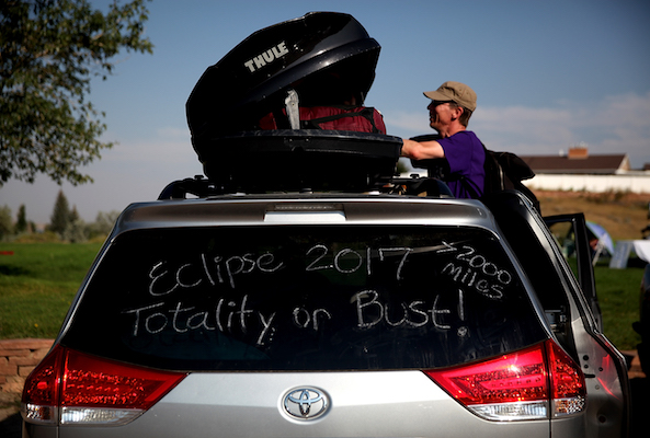 "<div class=""meta image-caption""><div class=""origin-logo origin-image kabc""><span>kabc</span></div><span class=""caption-text"">Brian Marriott of Boston, Massachusetts looks in a storage container on top of his car before watching the solar eclipse at South Mike Sedar Park on August 21, 2017. (Justin Sullivan/Getty)</span></div>"