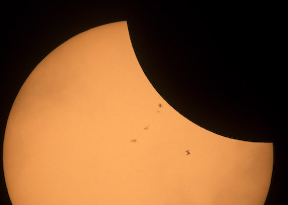 "<div class=""meta image-caption""><div class=""origin-logo origin-image kabc""><span>kabc</span></div><span class=""caption-text"">In this NASA handout, the International Space Station (bottom right), with a crew of six onboard, is seen in silhouette as it transits the Sun. (Joel Kowsky/NASA via Getty)</span></div>"