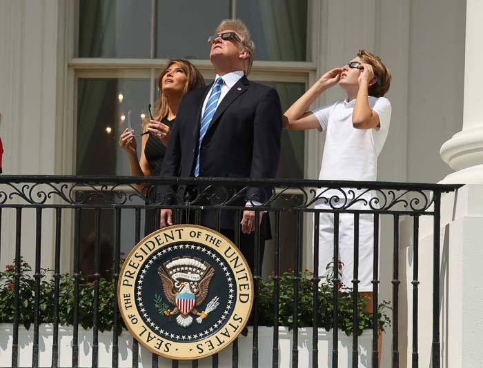 <div class='meta'><div class='origin-logo' data-origin='Creative Content'></div><span class='caption-text' data-credit='Andrew Harnik/AP'>President Donald Trump, first lady Melania Trump and their son Barron watch the solar eclipse from the White House.</span></div>