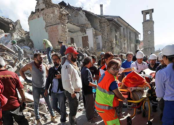 <div class='meta'><div class='origin-logo' data-origin='none'></div><span class='caption-text' data-credit='Alessandra Tarantino/AP Photo'>A victim is pulled out of the rubble following an earthquake in Amatrice Italy, Wednesday, Aug. 24, 2016.</span></div>
