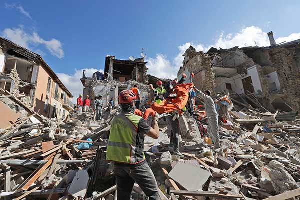 <div class='meta'><div class='origin-logo' data-origin='none'></div><span class='caption-text' data-credit='Alessandra Tarantino/AP Photo'>Rescuers search for survivors under the rubble of the town of Amatrice, central Italy, Wednesday, Aug. 24, 2016.</span></div>