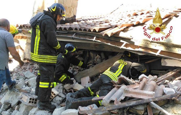 <div class='meta'><div class='origin-logo' data-origin='none'></div><span class='caption-text' data-credit='Italian Firefighters Vigili del Fuoco via AP'>Italian firefighters search for survivors under the rubble of the town of Amatrice, central Italy, Wednesday, Aug. 24, 2016 following an earthquake.</span></div>