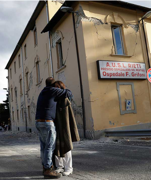 <div class='meta'><div class='origin-logo' data-origin='none'></div><span class='caption-text' data-credit='Alessandra Tarantino/AP Photo'>A woman is hugged outside a hospital building with visible cracks following an earthquake, in Amatrice, Italy, Wednesday, Aug. 24, 2016.</span></div>