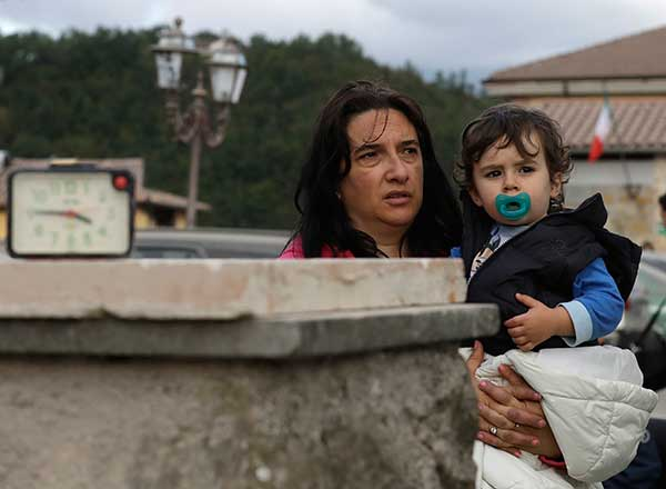 <div class='meta'><div class='origin-logo' data-origin='none'></div><span class='caption-text' data-credit='Alessandra Tarantino/AP Photo'>A woman and child stand in the street after an earthquake, in Amatrice, Wednesday, Aug. 24, 2016.</span></div>
