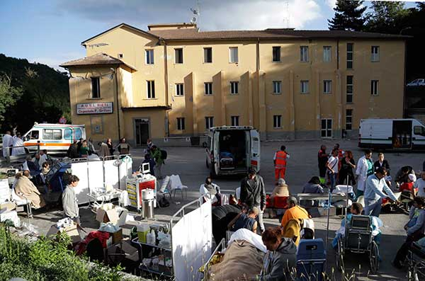 <div class='meta'><div class='origin-logo' data-origin='none'></div><span class='caption-text' data-credit='Alessandra Tarantino/AP Photo'>A makeshift medical camp is set up outside a hospital following an earthquake, in Amatrice, Italy, Wednesday, Aug. 24, 2016.</span></div>