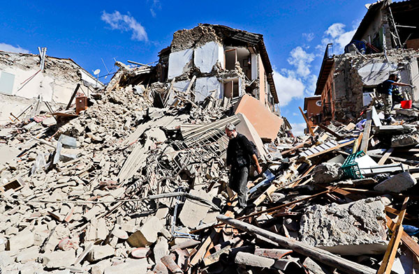 <div class='meta'><div class='origin-logo' data-origin='none'></div><span class='caption-text' data-credit='Alessandra Tarantino/AP Photo'>A man walks amid rubbles after an earthquake struck in Amatrice Italy, Wednesday, Aug. 24, 2016.</span></div>