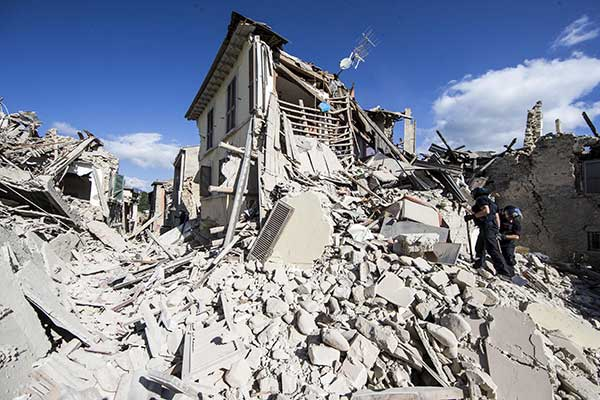<div class='meta'><div class='origin-logo' data-origin='none'></div><span class='caption-text' data-credit='Massimo Percossi/ANSA via AP'>Rescuers search for survivors under the rubble of the town of Amatrice, central Italy, Wednesday, Aug. 24, 2016 following an earthquake.</span></div>