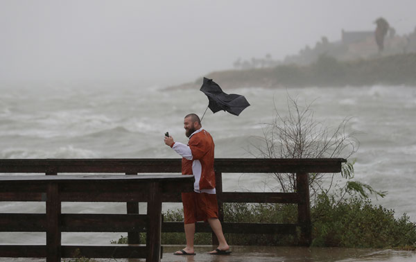 <div class='meta'><div class='origin-logo' data-origin='none'></div><span class='caption-text' data-credit='Eric Gay/AP Photo'>Matt Looingvill struggles with his umbrella as he tries to take a selfie in the wind and rain, Friday, Aug. 25, 2017, in Corpus Christi, Texas.</span></div>
