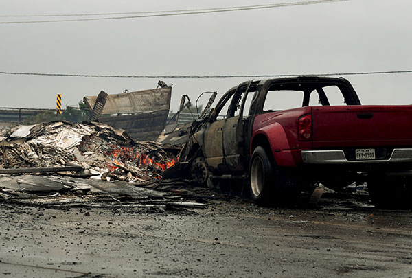 <div class='meta'><div class='origin-logo' data-origin='none'></div><span class='caption-text' data-credit='MARK RALSTON/AFP/Getty Images'>A burnt out house and cars that caught fire are seen after Hurricane Harvey hit Corpus Christi, Texas on August 26, 2017.</span></div>