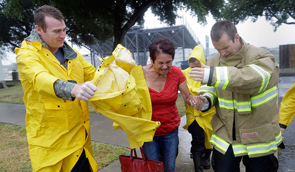 <div class='meta'><div class='origin-logo' data-origin='none'></div><span class='caption-text' data-credit='Eric Gay/AP Photo'>A woman is helped to a bus as she and other are evacuated as the outer bands of Hurricane Harvey begin to make landfall, Friday, Aug. 25, 2017, in Corpus Christi, Texas.</span></div>