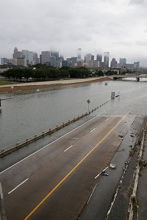 "<div class=""meta image-caption""><div class=""origin-logo origin-image none""><span>none</span></div><span class=""caption-text"">The downtown Houston skyline and flooded highway 288 are seen August 27, 2017 as the city battles with tropical storm Harvey and resulting floods. (THOMAS B. SHEA/AFP/Getty Images)</span></div>"