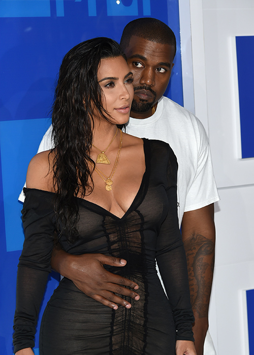 "<div class=""meta image-caption""><div class=""origin-logo origin-image ap""><span>AP</span></div><span class=""caption-text"">Kanye West, right, and Kim Kardashian West arrive at the MTV Video Music Awards at Madison Square Garden on Sunday, Aug. 28, 2016, in New York. (Evan Agostini/Invision/AP)</span></div>"