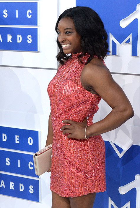 "<div class=""meta image-caption""><div class=""origin-logo origin-image ap""><span>AP</span></div><span class=""caption-text"">U.S. Olympic gymnast Simone Biles arrives at the MTV Video Music Awards at Madison Square Garden on Sunday, Aug. 28, 2016, in New York. (Evan Agostini/Invision/AP)</span></div>"