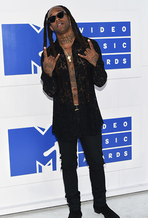 "<div class=""meta image-caption""><div class=""origin-logo origin-image ap""><span>AP</span></div><span class=""caption-text"">Ty Dolla $ign arrives at the MTV Video Music Awards at Madison Square Garden on Sunday, Aug. 28, 2016, in New York. (Evan Agostini/Invision/AP)</span></div>"