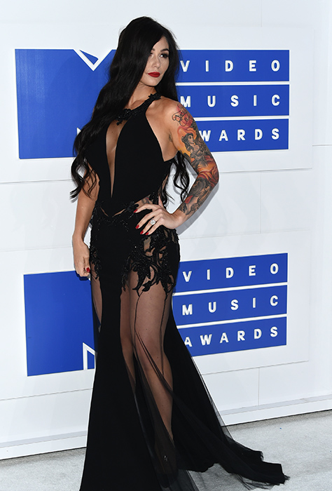 "<div class=""meta image-caption""><div class=""origin-logo origin-image ap""><span>AP</span></div><span class=""caption-text"">Jennifer ""JWoww"" Lynn Farley arrives at the MTV Video Music Awards at Madison Square Garden on Sunday, Aug. 28, 2016, in New York. (Evan Agostini/Invision/AP)</span></div>"