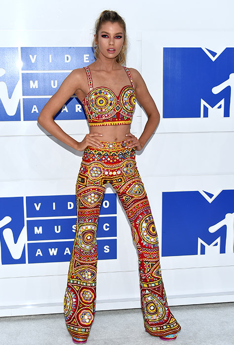 "<div class=""meta image-caption""><div class=""origin-logo origin-image ap""><span>AP</span></div><span class=""caption-text"">Stella Maxwell arrives at the MTV Video Music Awards at Madison Square Garden on Sunday, Aug. 28, 2016, in New York. (Evan Agostini/Invision/AP)</span></div>"