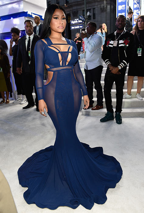 "<div class=""meta image-caption""><div class=""origin-logo origin-image ap""><span>AP</span></div><span class=""caption-text"">Nicki Minaj arrives at the MTV Video Music Awards at Madison Square Garden on Sunday, Aug. 28, 2016, in New York. (Evan Agostini/Invision/AP)</span></div>"