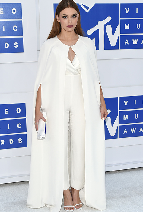 "<div class=""meta image-caption""><div class=""origin-logo origin-image ap""><span>AP</span></div><span class=""caption-text"">Holland Roden arrives at the MTV Video Music Awards at Madison Square Garden on Sunday, Aug. 28, 2016, in New York. (Evan Agostini/Invision/AP)</span></div>"