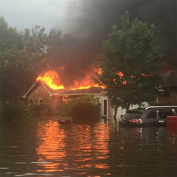 <div class='meta'><div class='origin-logo' data-origin='none'></div><span class='caption-text' data-credit='alemley29/Instagram'>A neighbor does not believe anyone was home in this burning building in Friendswood, Texas. Firefighters were unable to reach it.</span></div>