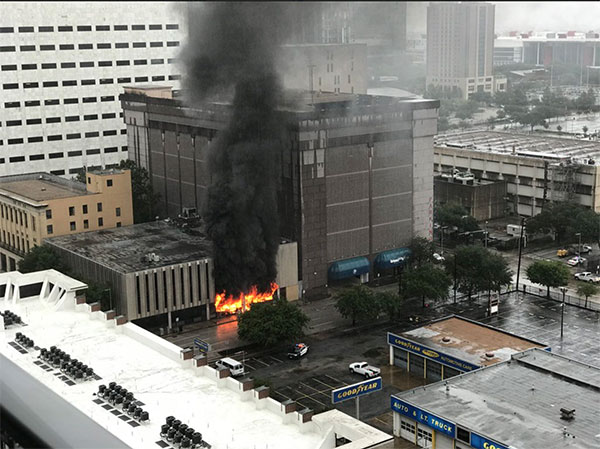 <div class='meta'><div class='origin-logo' data-origin='none'></div><span class='caption-text' data-credit='Chris Hisle/Twitter'>An explosion has rocked a building on Fannin Street in downtown Houston on Monday.</span></div>